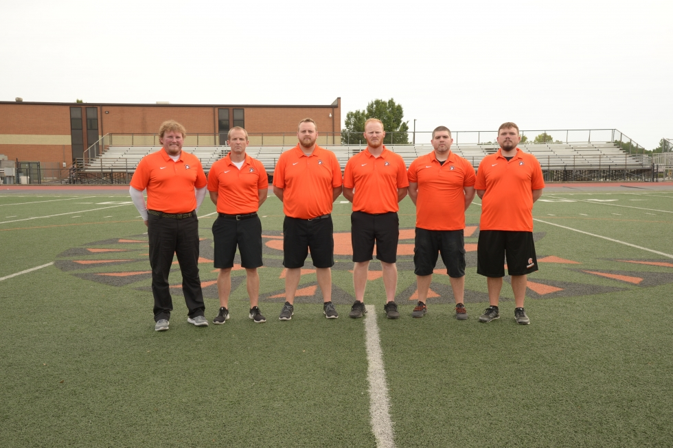 men in orange polo shirts