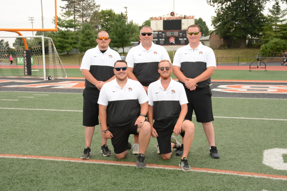 men wearing white and black shirts with sunglasses