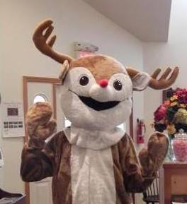 Costumed person wearing a reindeer costume