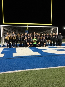 Girls soccer team in front of a net