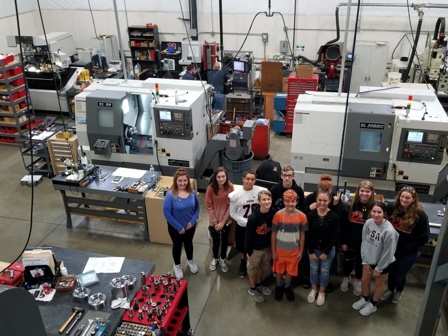 students in a manufacturing plant