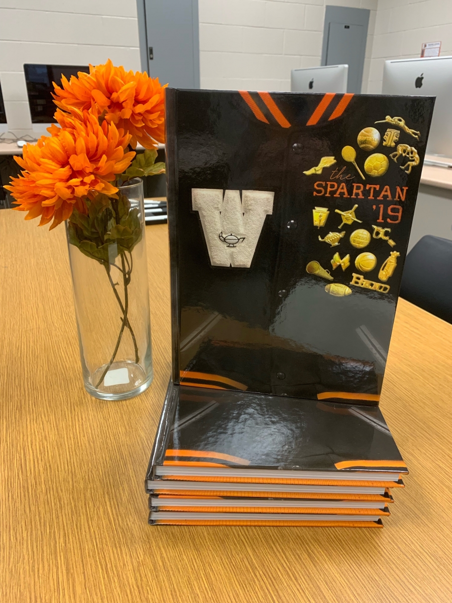 image of a book with orange flowers in a vase