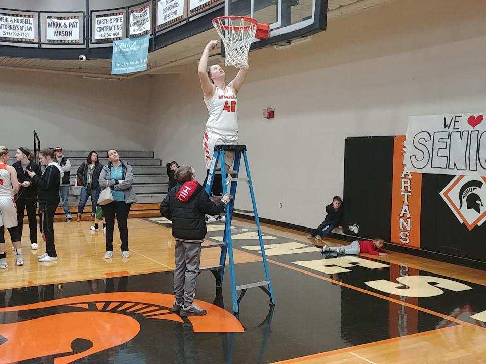 Cutting down a basketball net
