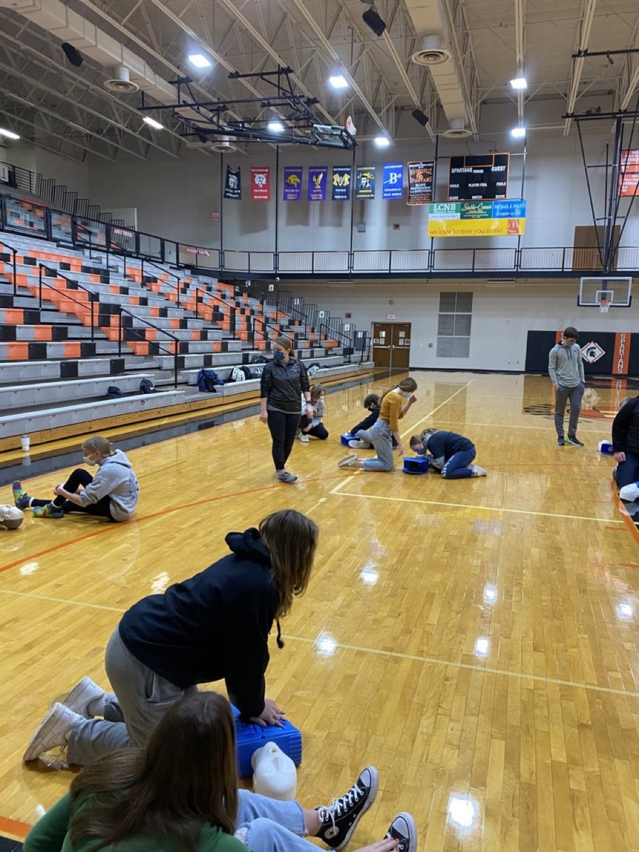 Students in a gym doing CPR