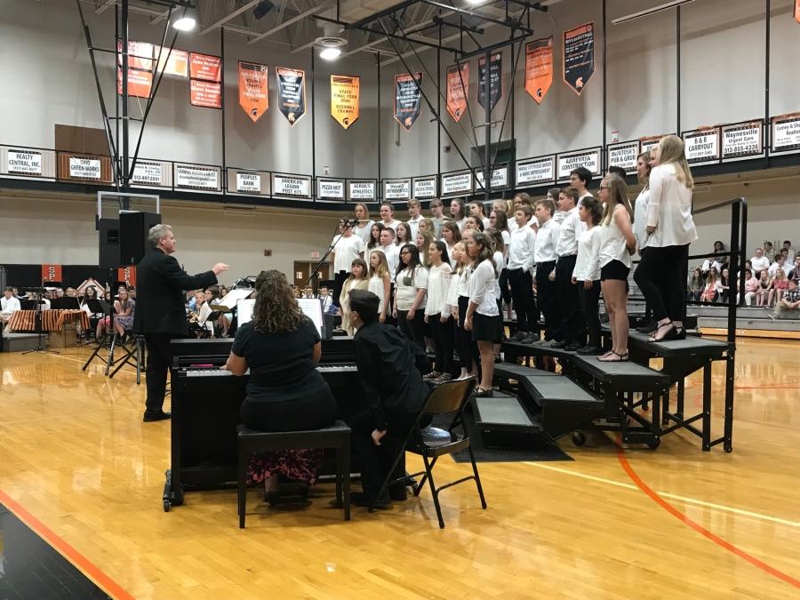 choir students in bleachers