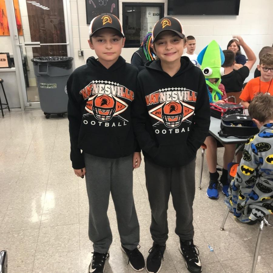 two boys wearing matching hoodies