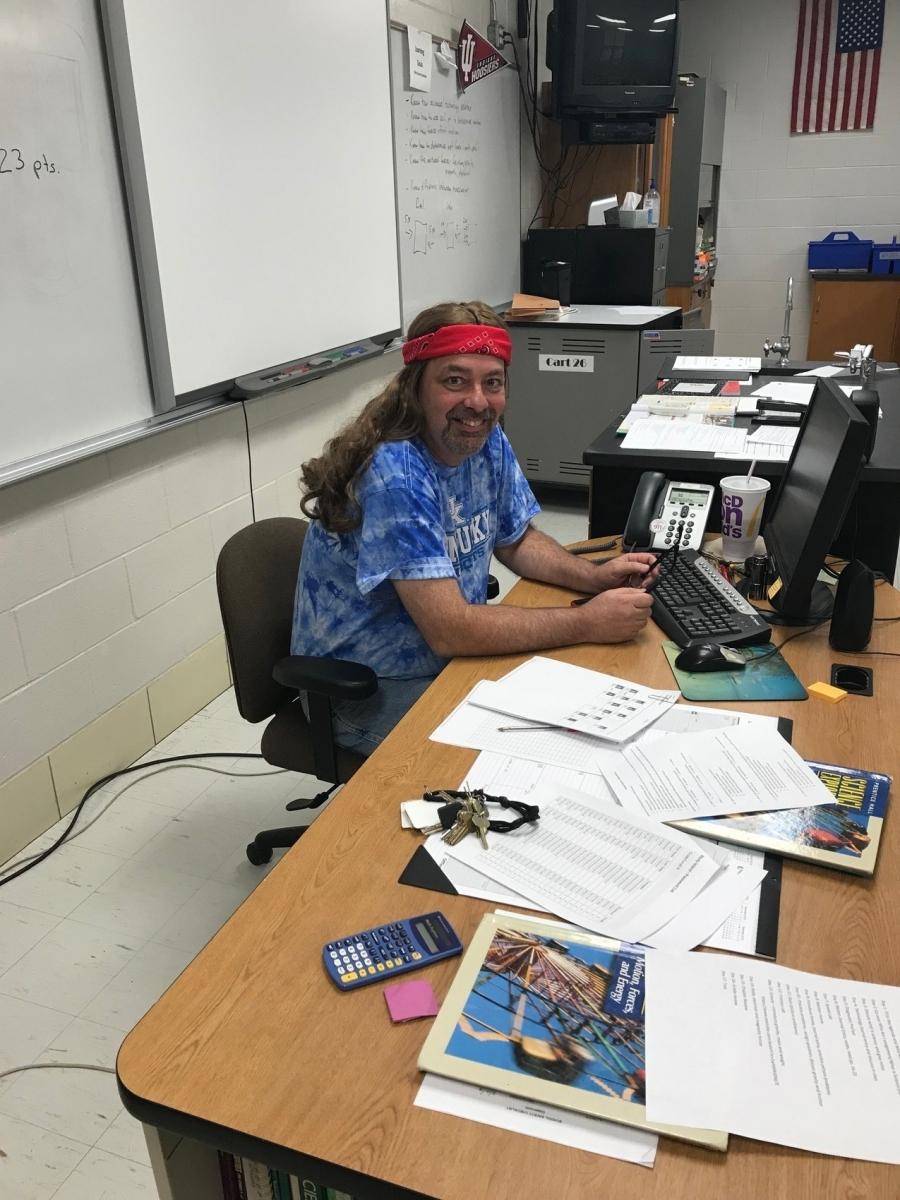 guy wearing long hair wig and bandana