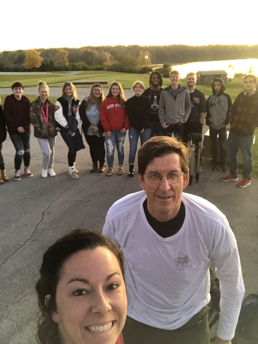 image of a selfie with students in background