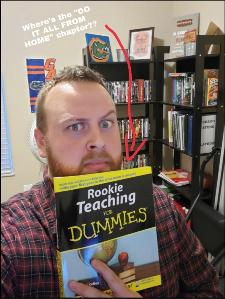 teacher holding a book with an arrow