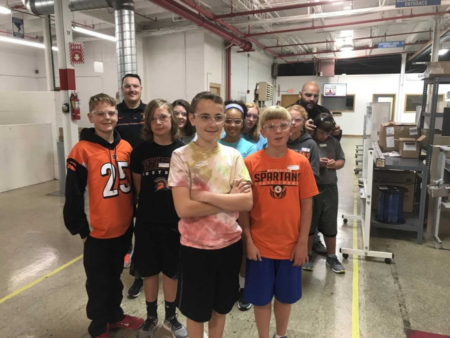 students on a tour of a manufacturing plant