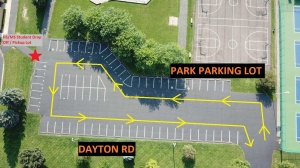 parking lot image with yellow arrows