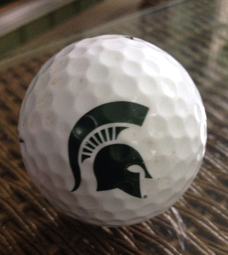 golf ball with a spartan head on it