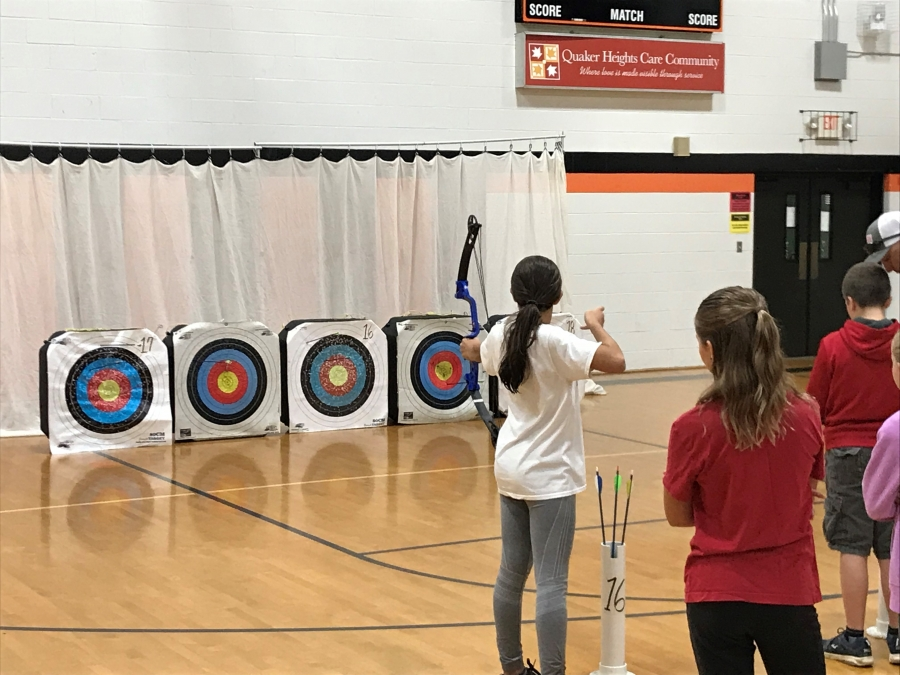 girl shooting at archery targets