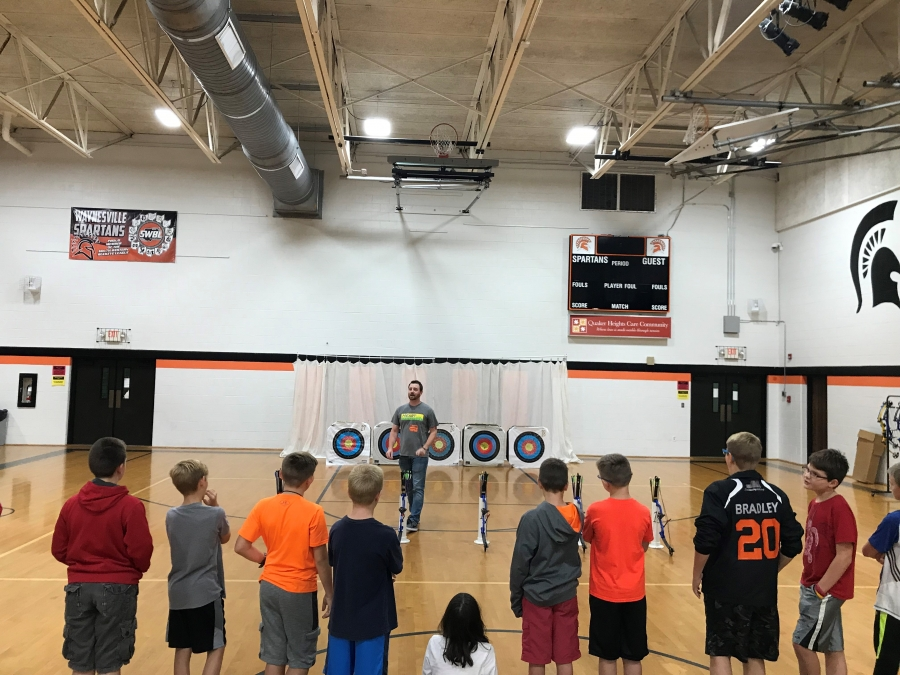 man in front of archery targets