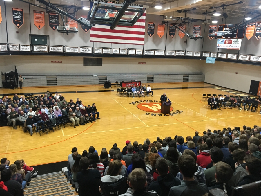 image of a gym filled with people in chairs