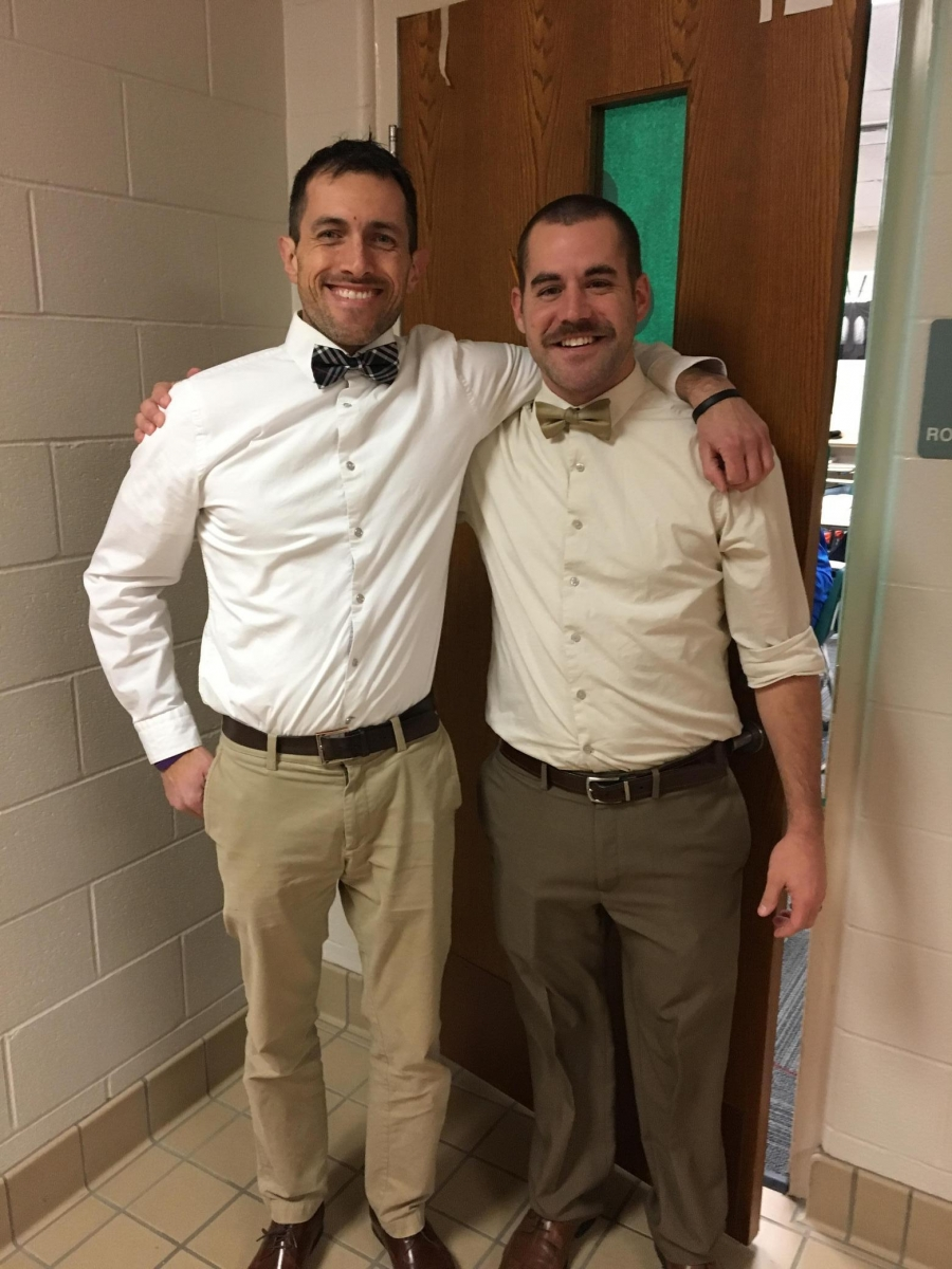 two men wearing bow ties