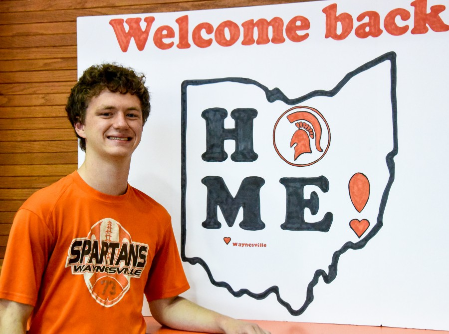 image of a boy with the state of Ohio poster behind him