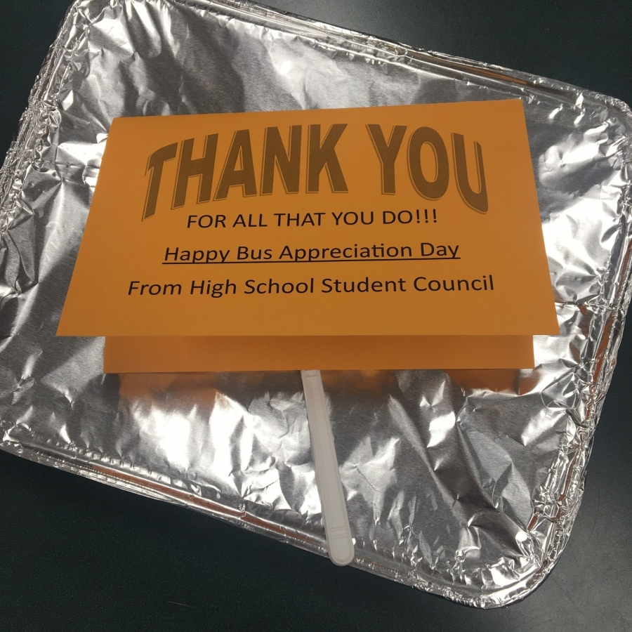 orange thank you tag on a tin foil pan