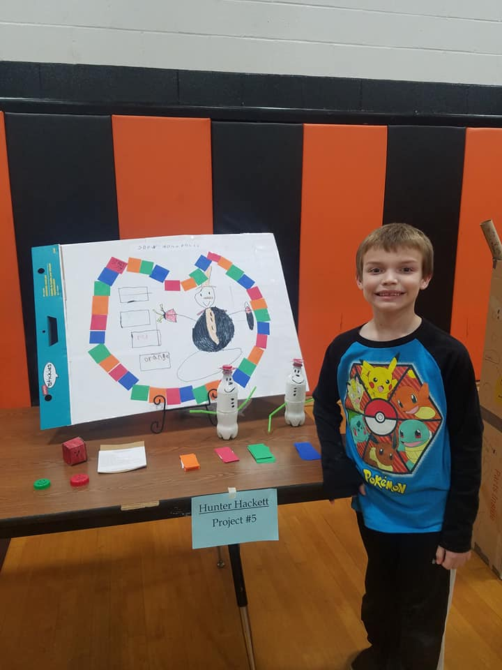 boy standing in front of a display