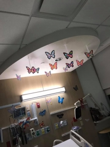 butterflies hanging from a ceiling in a hospital