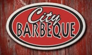 wood background with city bbq in a circle