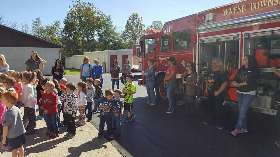 fire truck and young students
