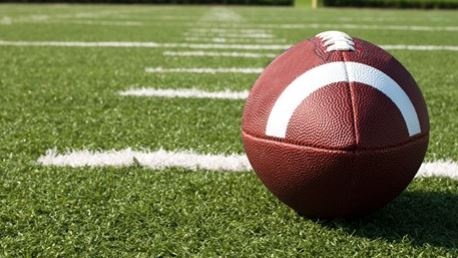 football sitting on turf field