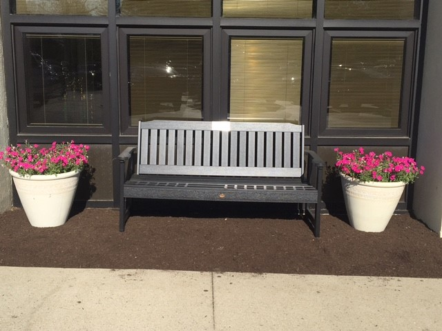 bench with two flower pots