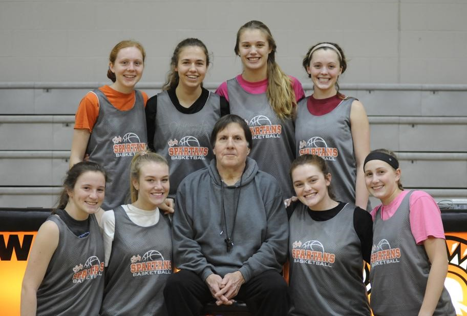 girls basketball team with coach in the middle