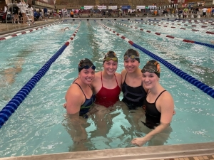 group of four female swimmers