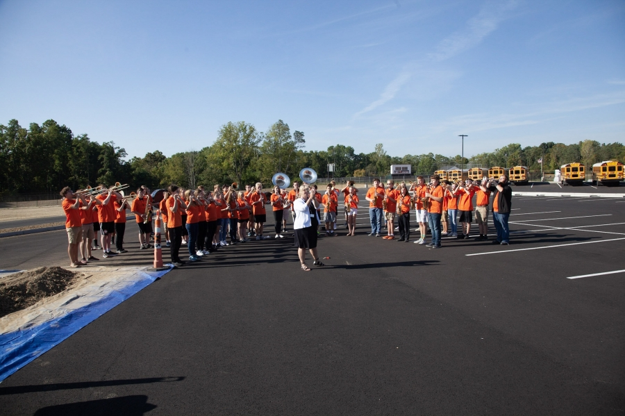 band wearing orange shirts