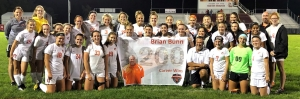 soccer team with a banner in front