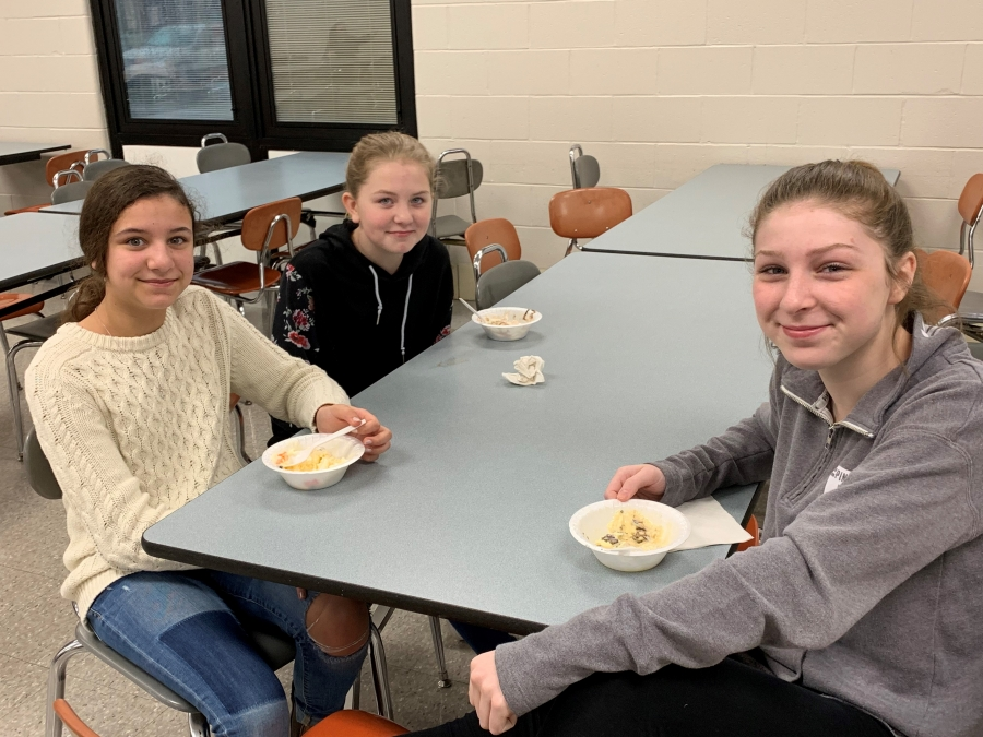 students at tables with bowls of ice cream