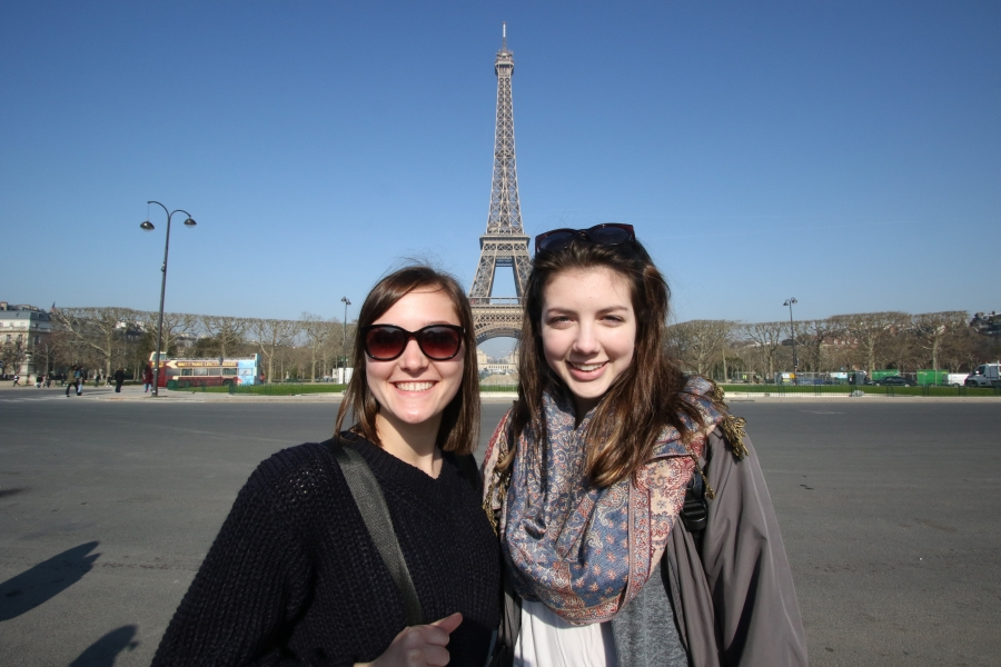 2 girls with eiffel tower in background