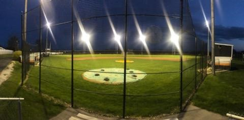 baseball diamond with lights on