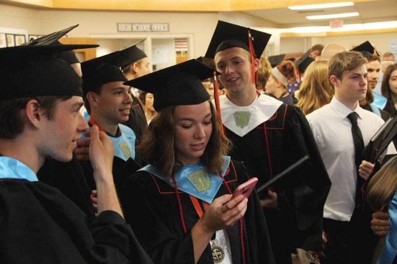 students looking at diplomas