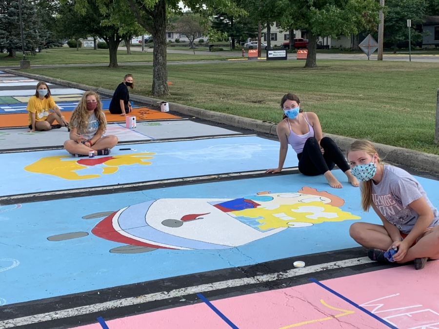 image of students painting parking spots