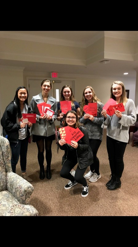 girls holding valentine cards