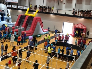 jumping blow up toys in a gym