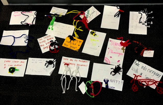pipe cleaner animals with notes attached