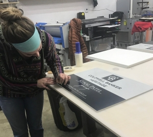 girl working on a poster