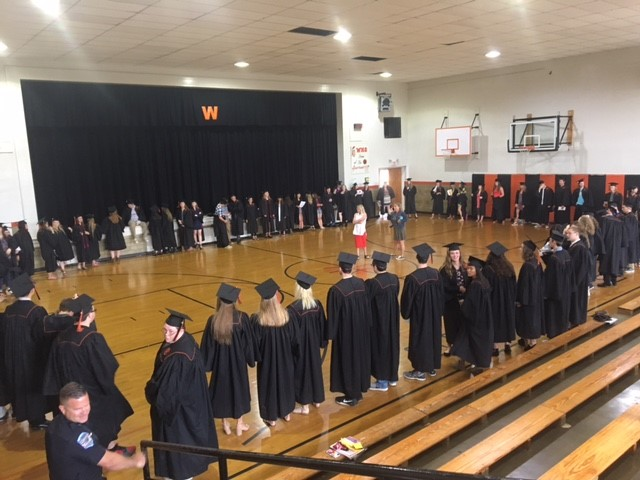 graduates standing in a giant circle