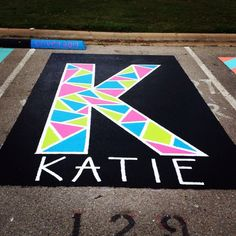 colorful letter K in a parking spot