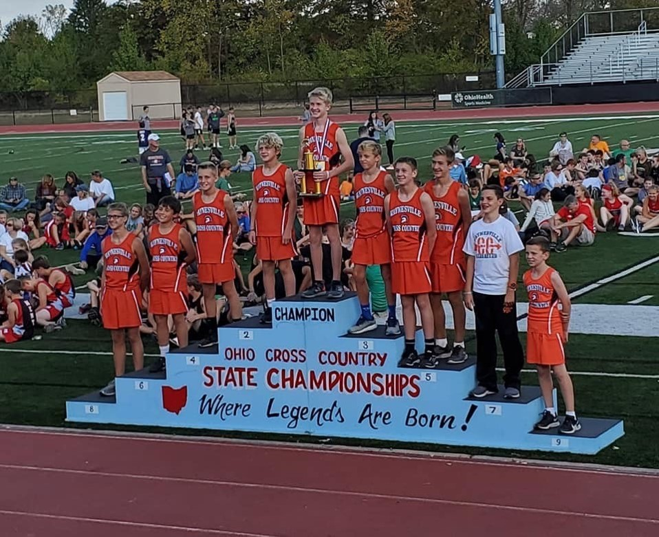boys cross country team in orange uniforms