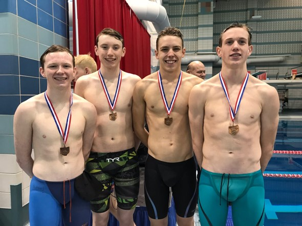 male swimmers with medals on necks