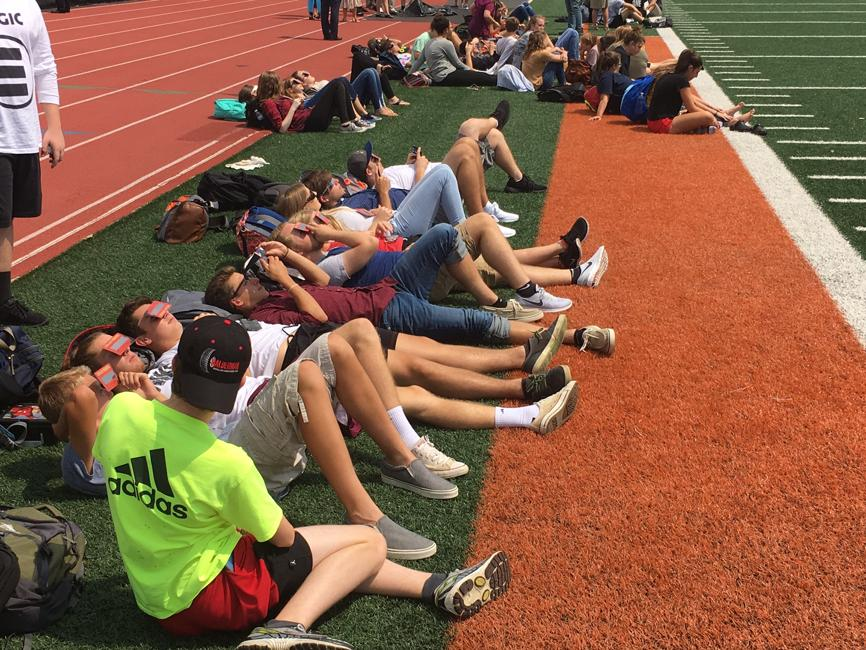 image of students watching eclipse