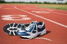 image of a pair of running shoes on a track