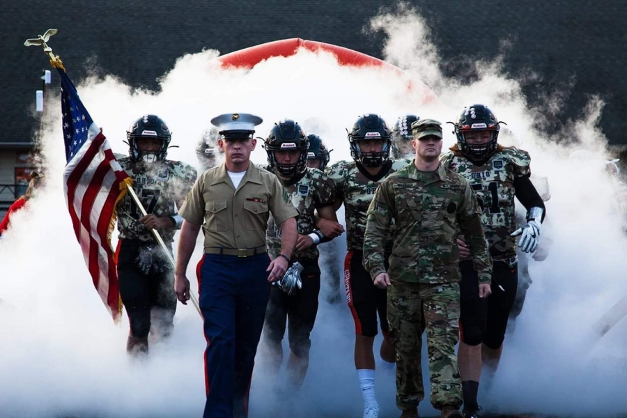 military and football people with smoke