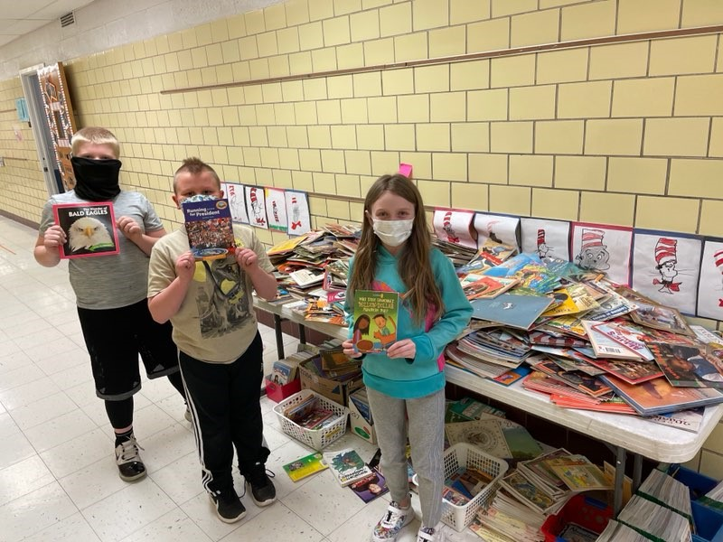 kids with books on a table