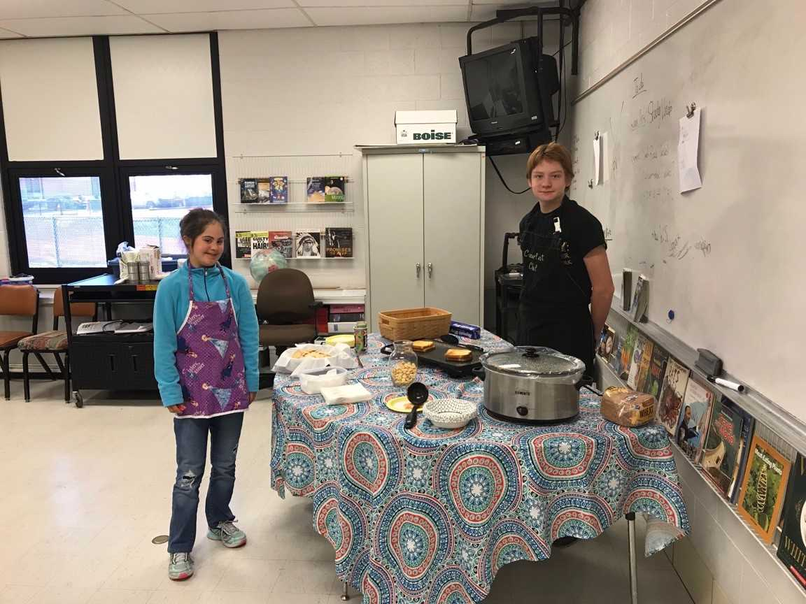 two students cooking food